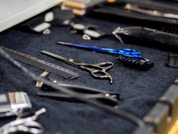 Close-up barber shop accessories on a desk