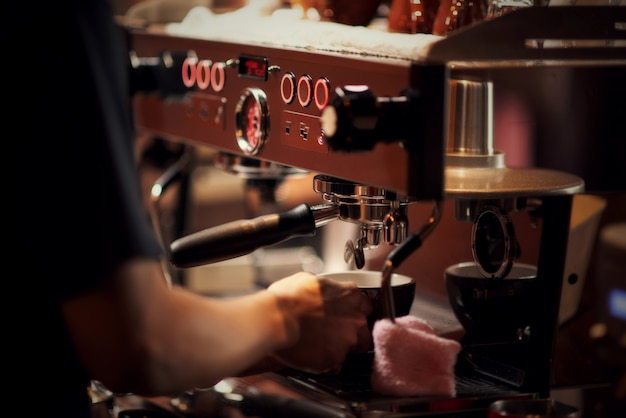 Close up barista making cappuccino, bartender preparing coffee drink