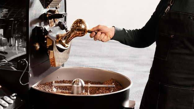 Close-up barista with coffee beans