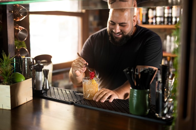 Close up on bartender creating delicious drink