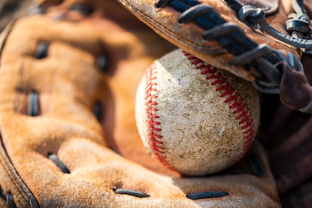Close-up of baseball in glove