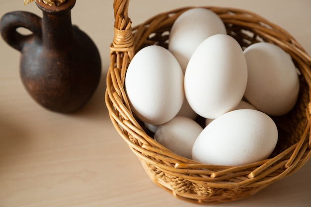 Close up of a basket with raw white eggs to cook a meal organic products just came from a farm
