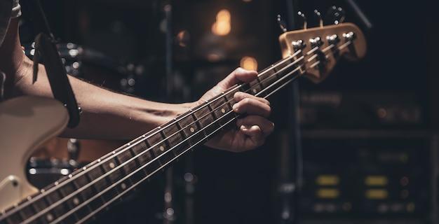 Close up of bass guitar copy space.