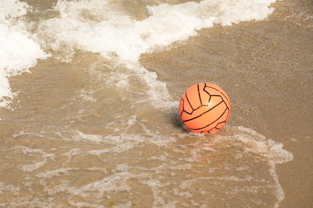 Close up beach ball in water