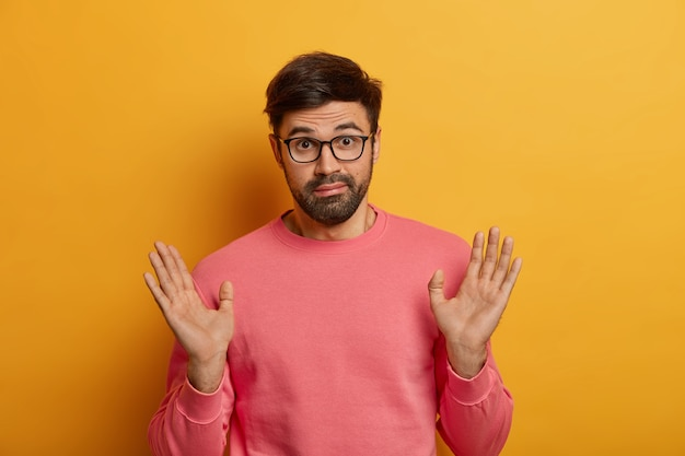 Close up on bearded young man wearing glasses isolated