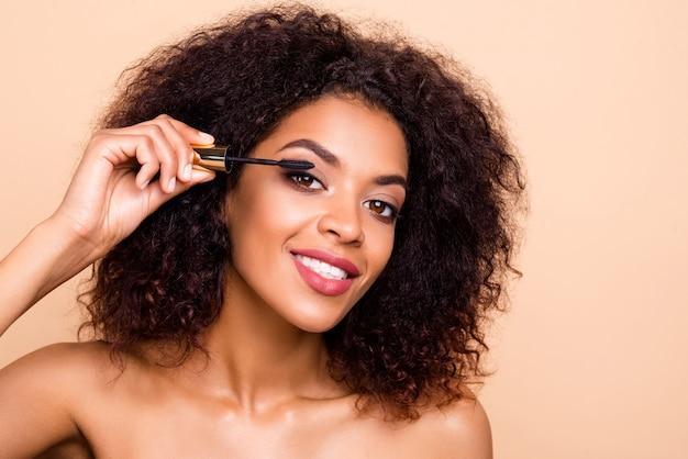 Close up beautiful amazing model lady hold new applicator makeup studio