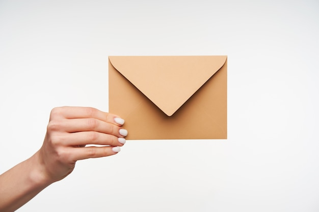 Close up on beautiful hands holding blank envelope of paper