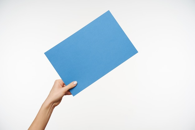 Close up on beautiful hands holding blank sheet of paper
