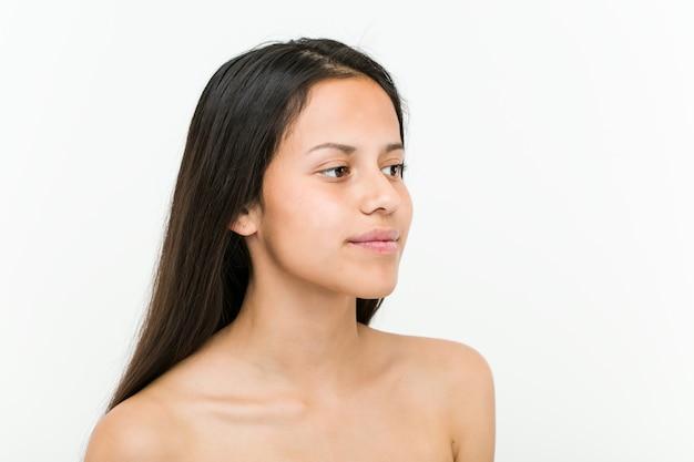 Close up of a beautiful and natural hispanic young woman