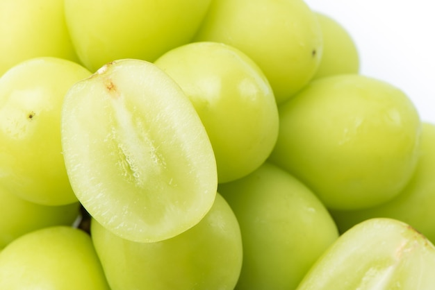 Close up of beautiful shine muscat green grape isolated on white background