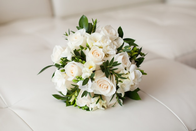 Close up of beautiful wedding bouquet on white surface