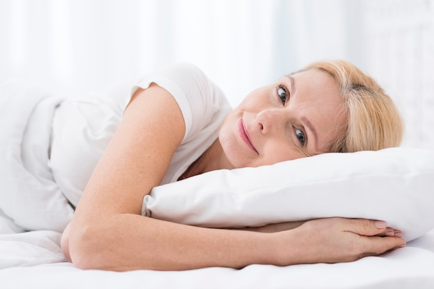 Close-up beautiful woman ready to take a nap