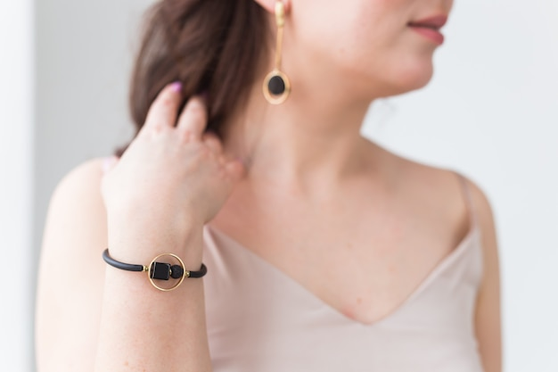 Close-up of beautiful woman wearing bracelet. accessories, jewelry and bijouterie concept.