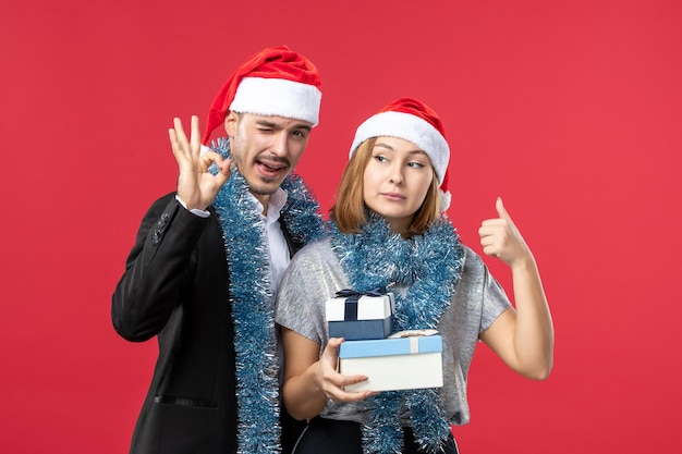 Close up on beautiful young couple wearing santa hats isolated