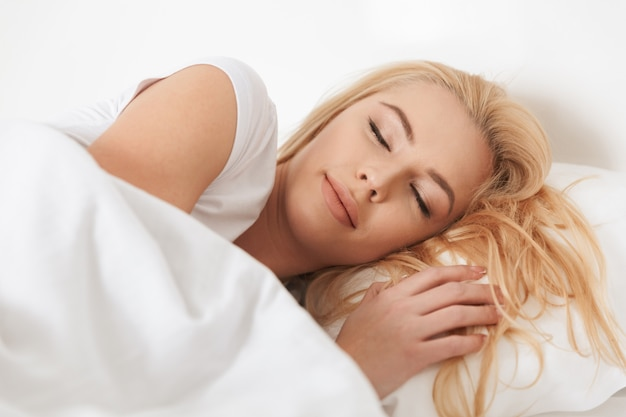Close up of a beautiful young woman sleeping