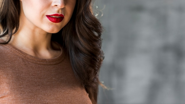 Close-up of a beautiful young woman with red lips