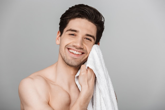 Close up beauty portrait of half naked smiling young man