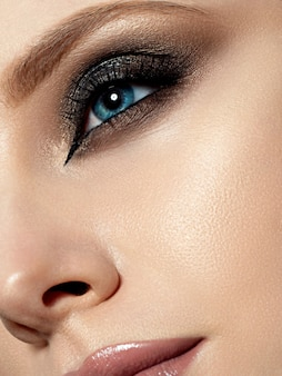 Close up beauty portrait of young woman with beautiful fashion makeup