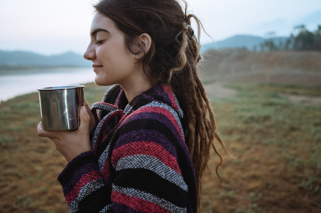 Close up a beauty woman drink a cup of coffee after wake up