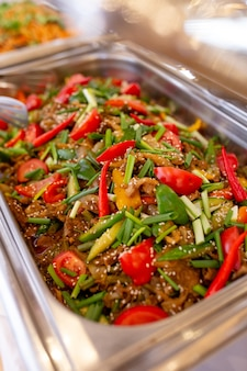 Close-up beef with tomatoes, peppers and herbs in mamrit