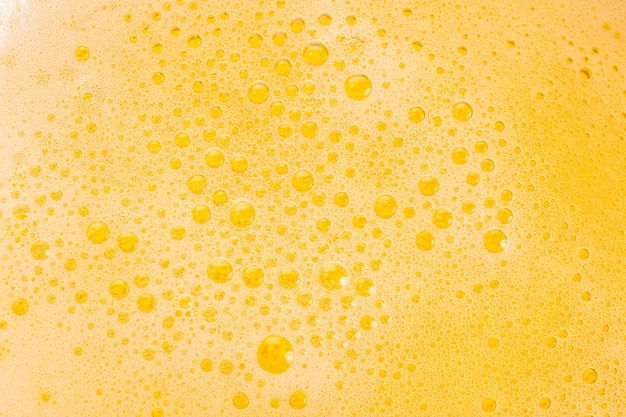 Close up of beer bubbles and foam as a background