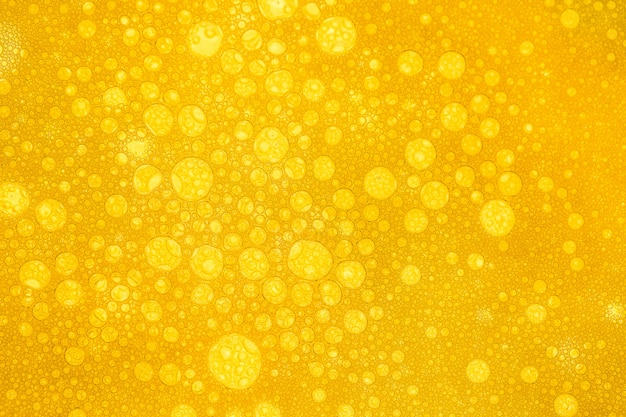 Close up of beer bubbles and foam as a