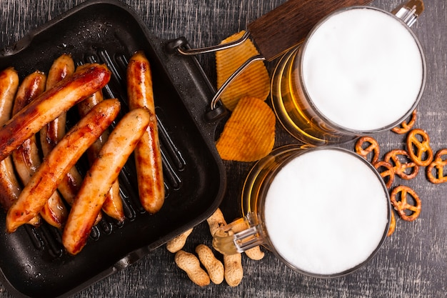 Close-up beer with sausages