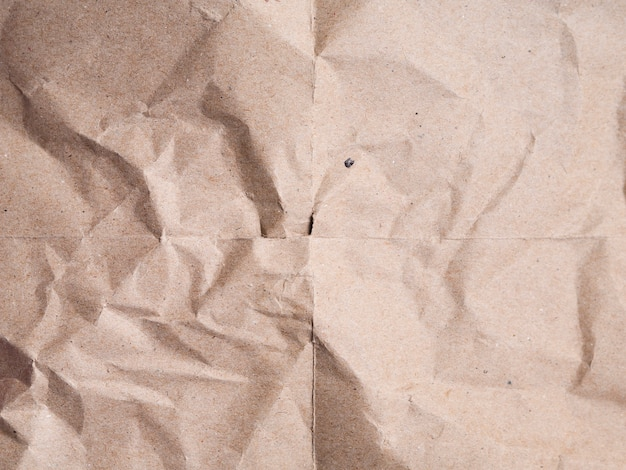 Close-up beige crumpled paper background
