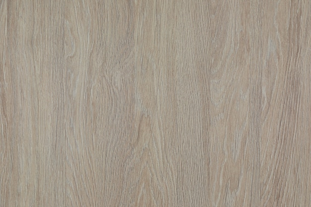 Close-up of beige-grey surface of wooden laminate