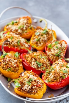 Close-up of bell peppers stuffed with quinoa.