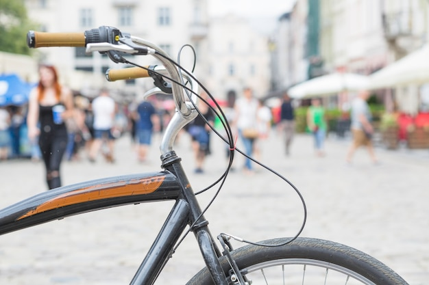 Close-up of a bicycle parked in city