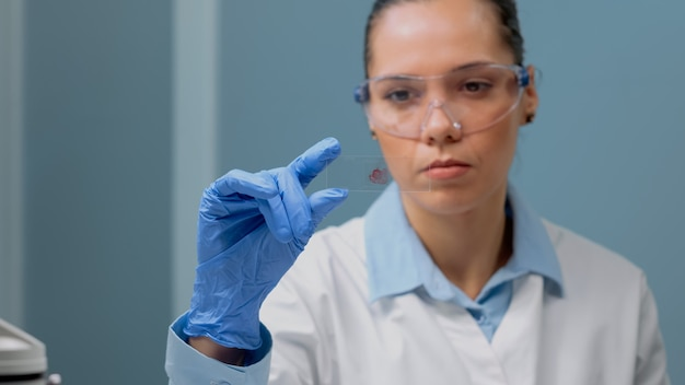 Close up of biology doctor looking at blood test