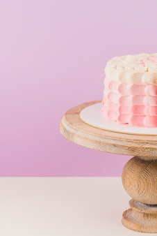 Close-up of a birthday cake on wooden cakestand
