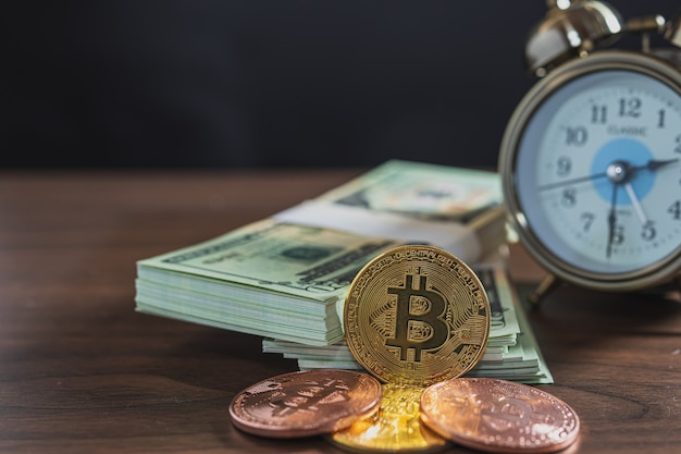 Close up of bitcoin and bank notes on the table