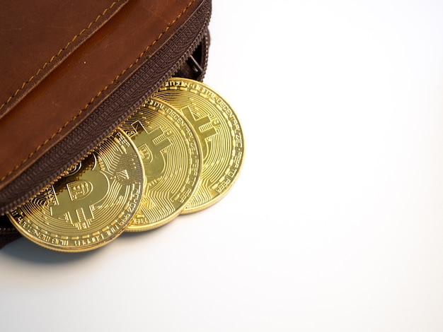 Close up bitcoin gold coins with wallet on the white background.