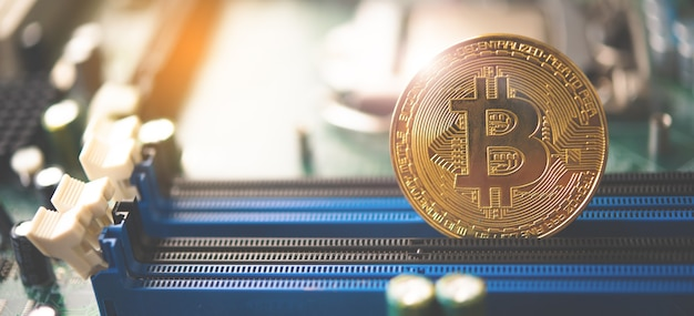 Close-up bitcoin and its business-class laptop work and bring transactions across the network and help with today's business management,