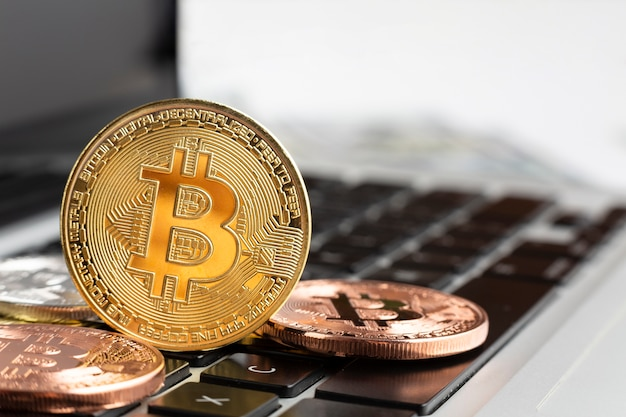 Close-up of bitcoin on top of laptop