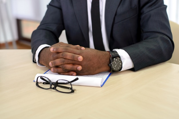 Close-up of a black businessman keeping fingers.