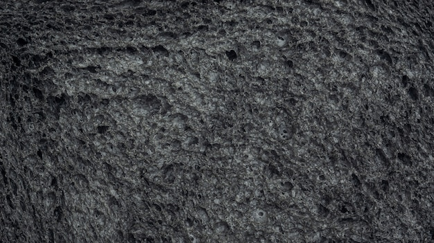 Close up of black charcoal bread for a background.