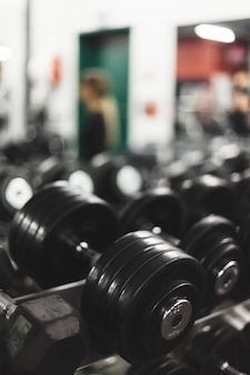 Close-up of a black dumbbell in gym