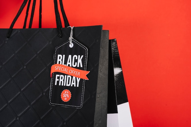 Close-up black friday sign on shopping bag
