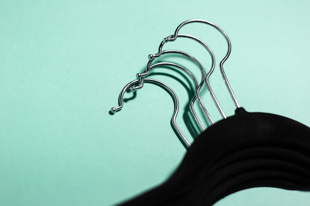 Close-up of black hangers for clothes