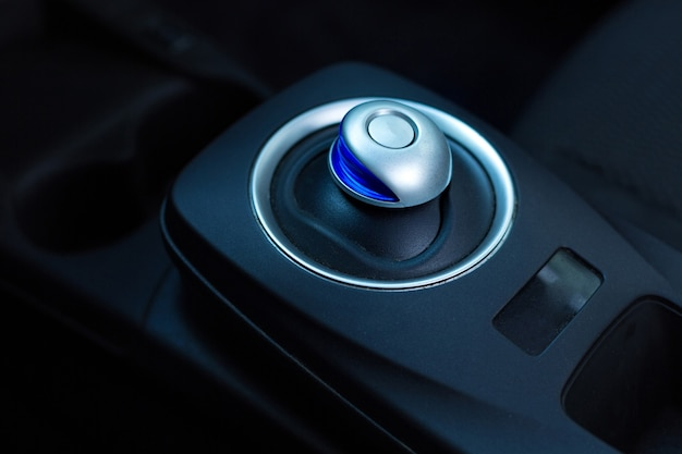 The close up of a black hitech classy gearbox in a car using electricity as a source of energy