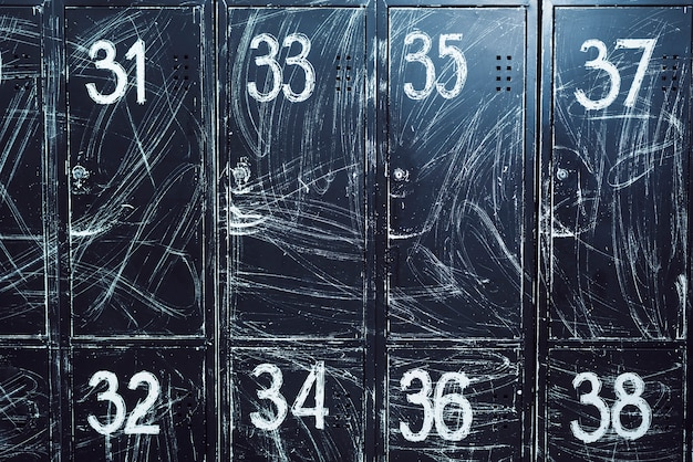 Close-up of black lockers with numbers
