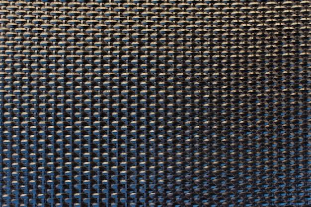 Close-up black plastic wattled grid texture pattern