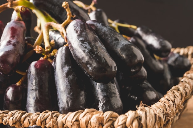 Close up of black seedless moon drops grape or witch fingers grape in basket