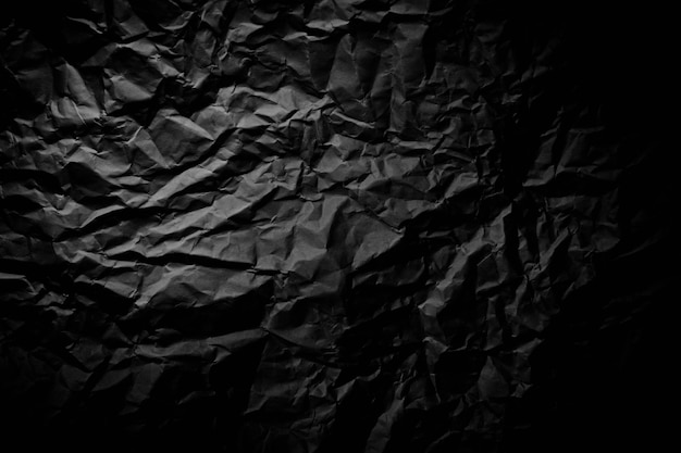 Close up of black wrinkle crumpled old with paper page texture rough background.