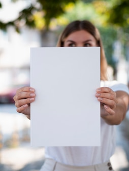 Close-up blank magazine held by a woman