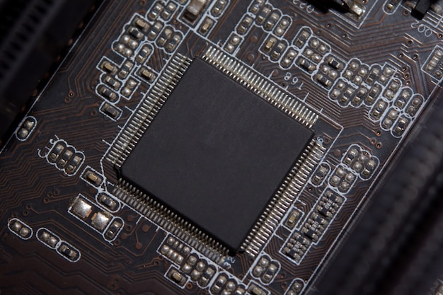 Close up blank microchip on electronic circuit board.