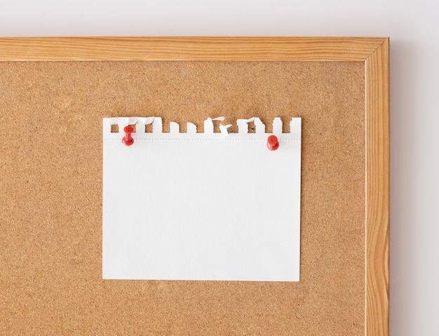 Close up blank paper sheet mockup pinned over board.